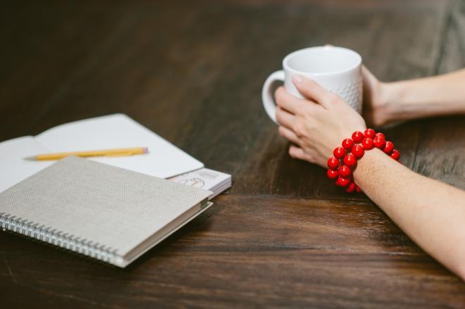Bright red bracelet stack.